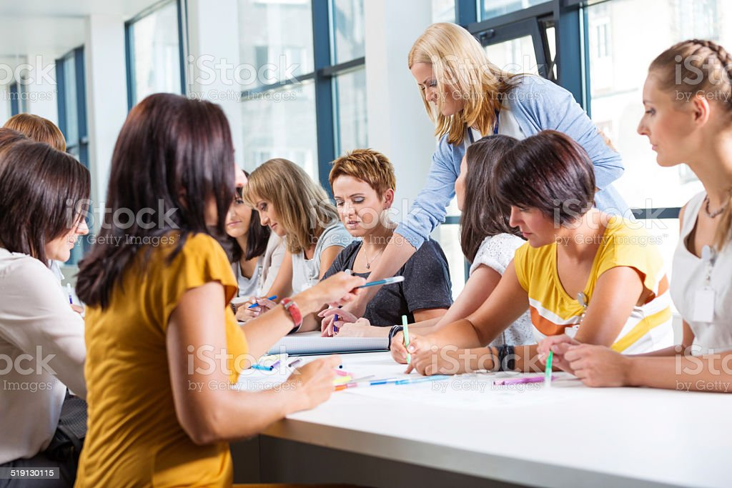 Group of women at the training Group of women attending a training, working together and discussing. 30-39 Years Stock Photo