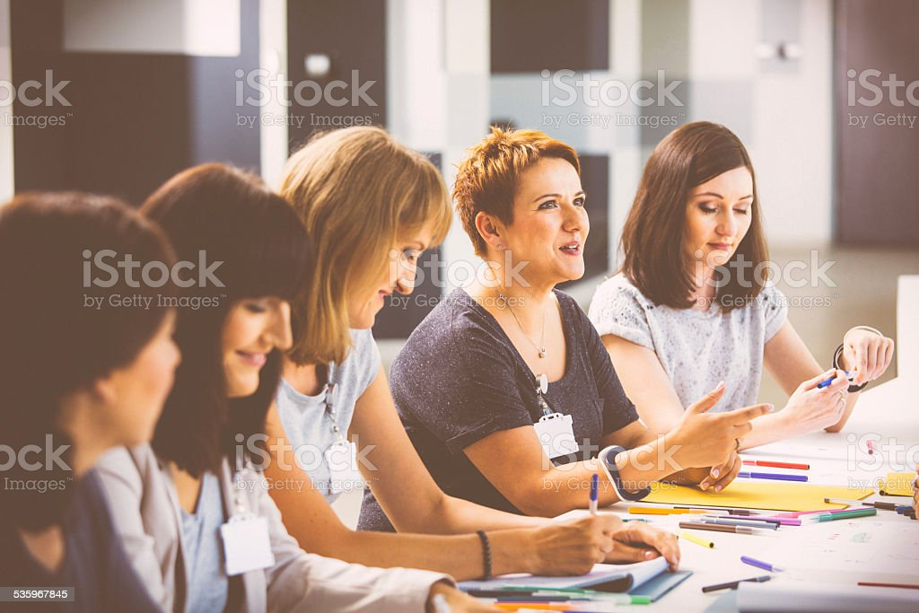 Group of women at the training Group of women attending a training, working together and discussing. 2015 Stock Photo