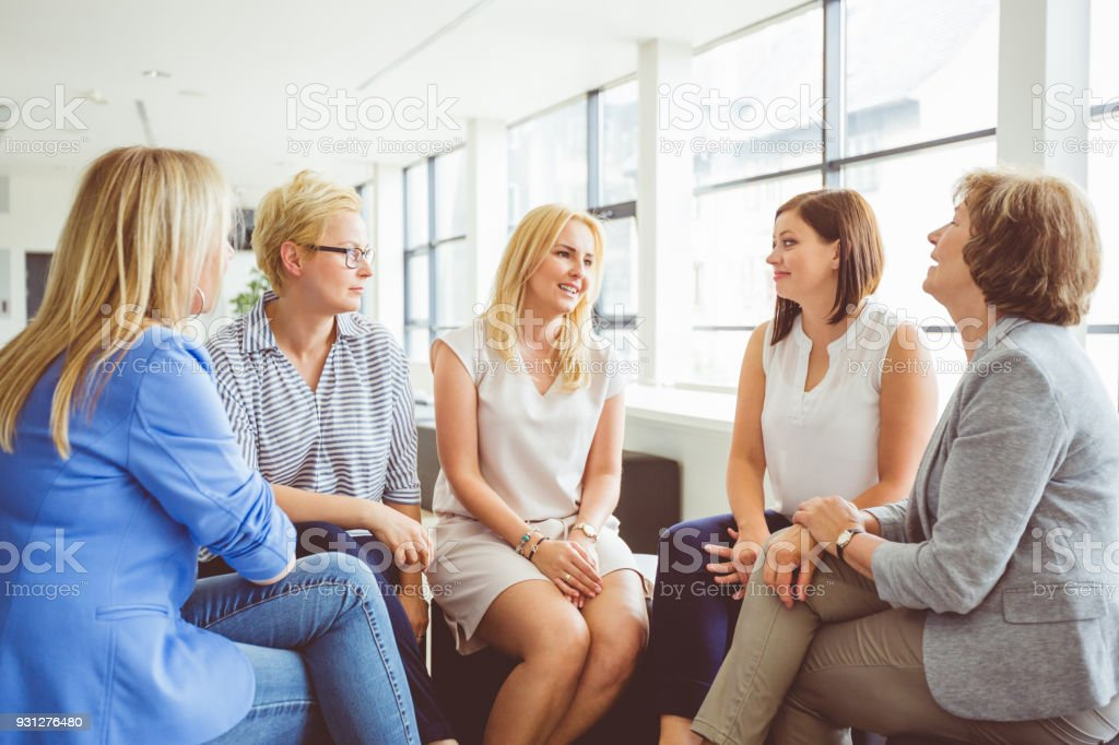 Group of women at the training Group of women at the training, sitting in circle and talking. Adult Stock Photo