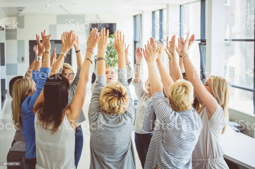Group of women at the training Group of women at the training, raising arms together. A Helping Hand Stock Photo