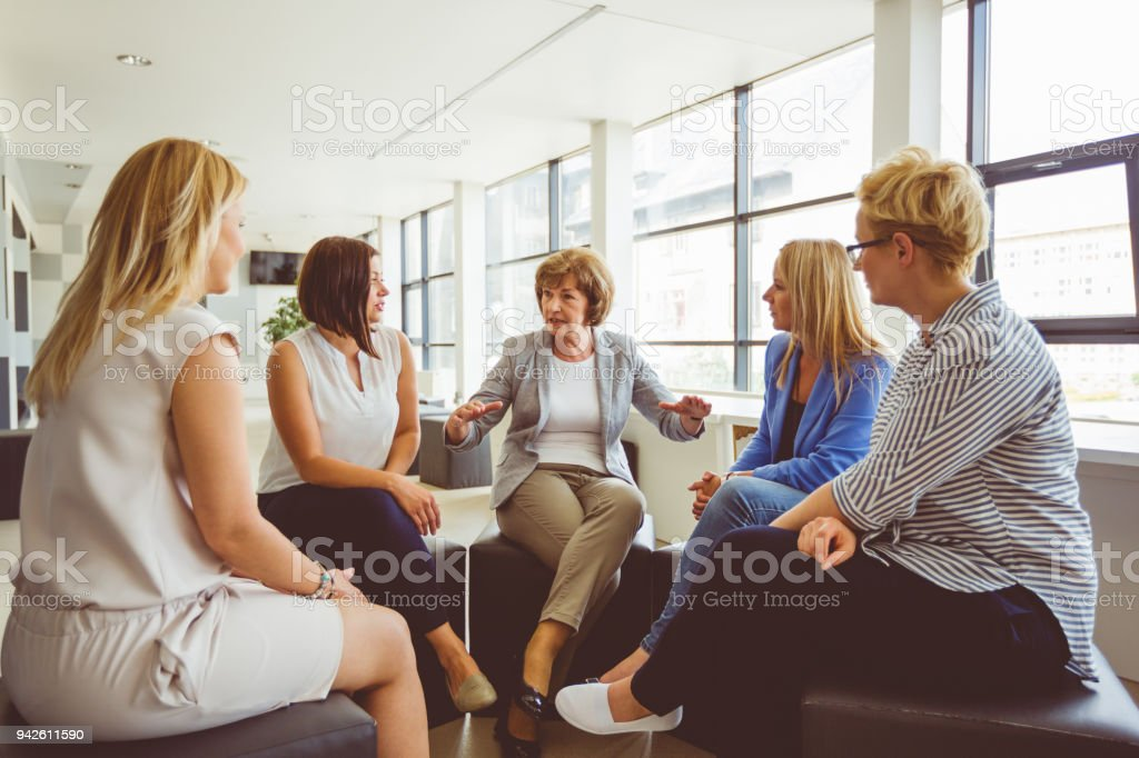Group of women at the training Women at the training, sitting in circle and talking. Adult Stock Photo