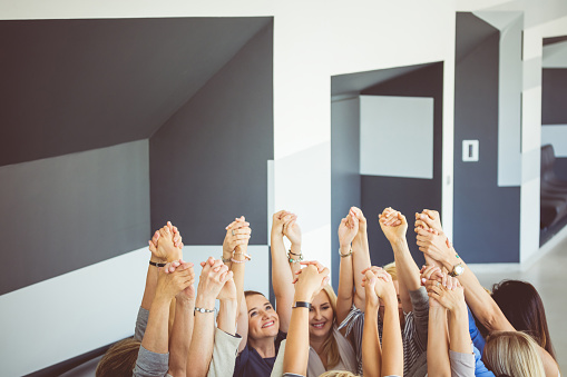 Group Of Women At The Training Raising Hands Stock Photo - Download Image Now