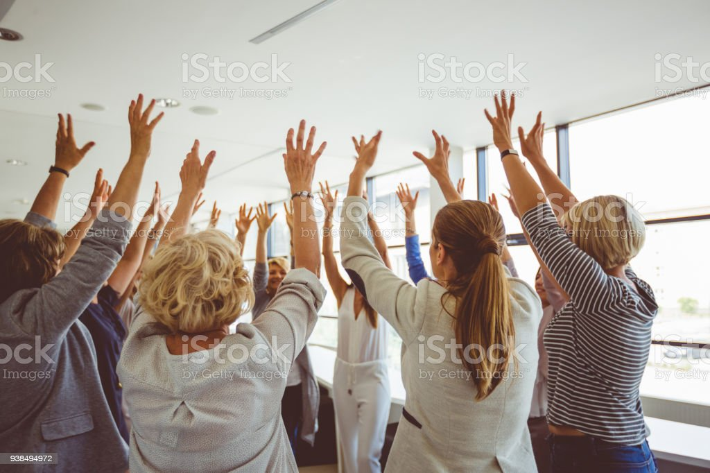 Group of women at the training raising hands together Group of women at the training, raising arms together. Unrecognizable people. A Helping Hand Stock Photo