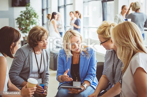 987123762 istock photo Group of women brainstorming during a training 1094459900