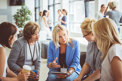 Group Of Women Brainstorming During A Training Stock Photo - Download Image Now