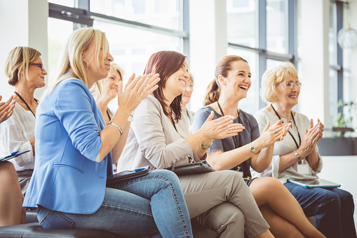 Group Of Women Clapping At Seminar Stock Photo - Download Image Now
