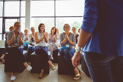 Group Of Women Clapping Hands During Seminar Stock Photo - Download Image Now