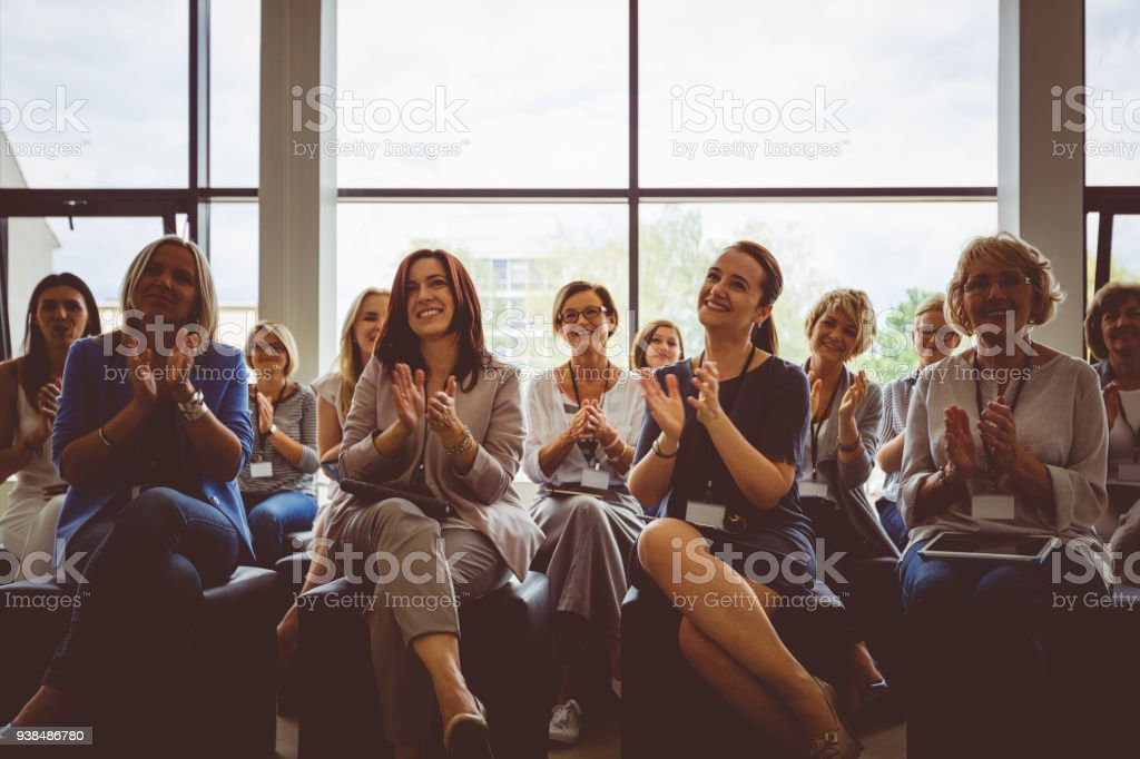 Group of women clapping hands during seminar Group of women clapping hands during seminar. Achievement Stock Photo