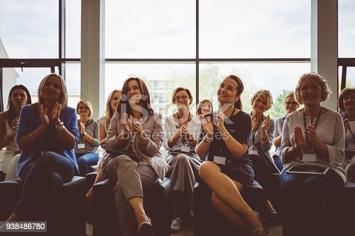 istock Group of women clapping hands during seminar 938486780