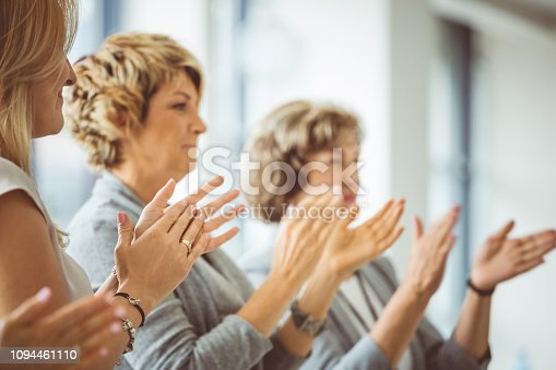 858148040 istock photo Group of women clapping hands during training session 1094461110
