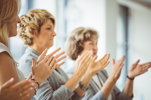 Group Of Women Clapping Hands During Training Session Stock Photo - Download Image Now