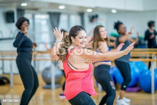 897892972 istock photo Group Of Women Dancing 897892962