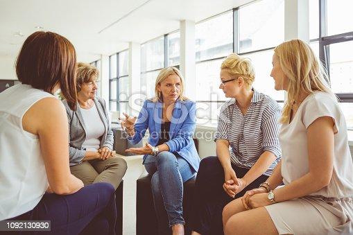 987123762 istock photo Group of women discussing at the training 1092130930