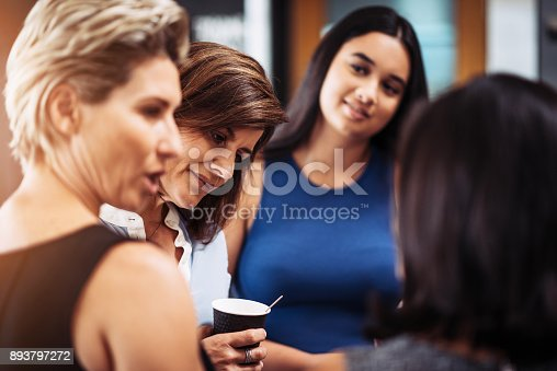 istock Group of women discussing project development during coffee break 893797272