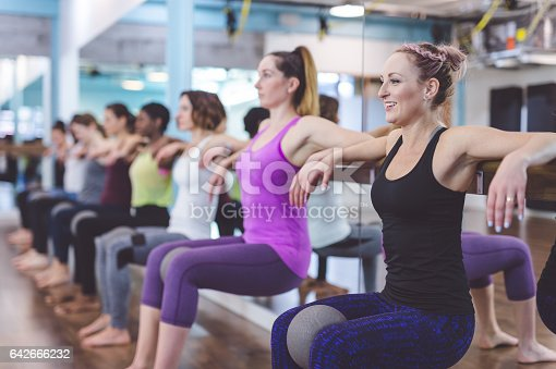 istock Group of Women Doing Barre + TRX Workout 642666232