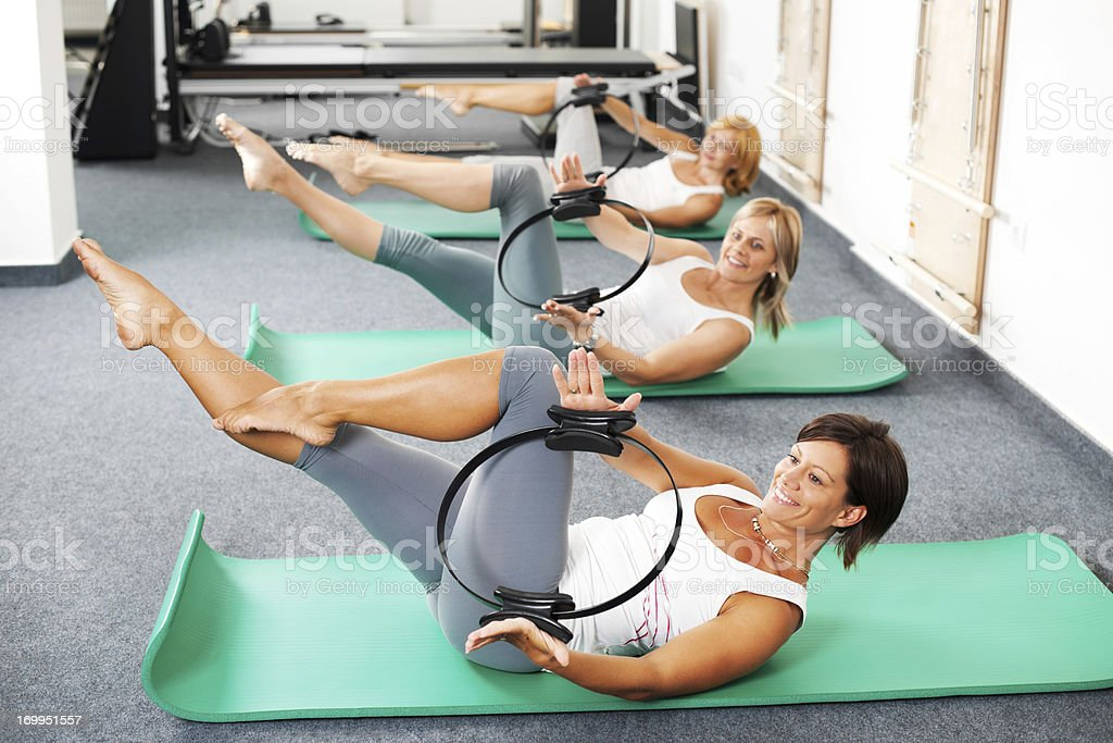 Group of women doing Pilates exercises royalty-free stock photo
