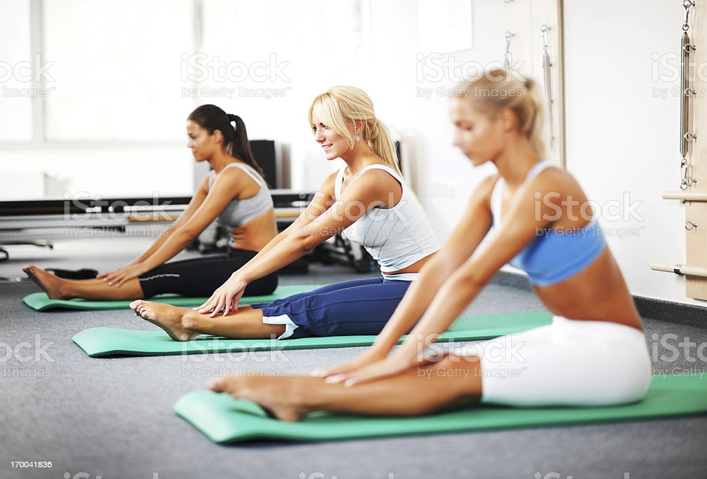 Group of women doing Pilates exercises. royalty-free stock photo