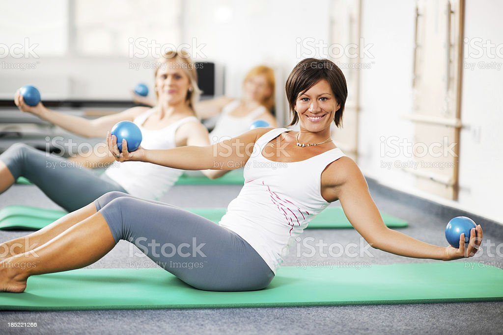 Group of women doing Pilates exercises stock photo