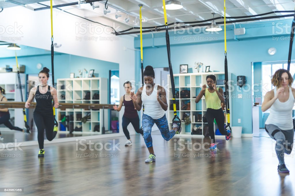 Group of Women Doing TRX Workout stock photo