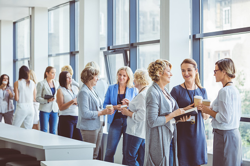 Group Of Women During A Break In Seminar Stock Photo - Download Image Now