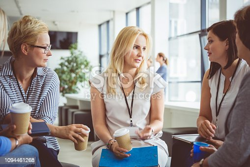 1055095320 istock photo Group of women during a training coffee break 1094461268