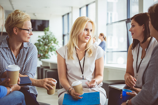 Group Of Women During A Training Coffee Break Stock Photo - Download Image Now