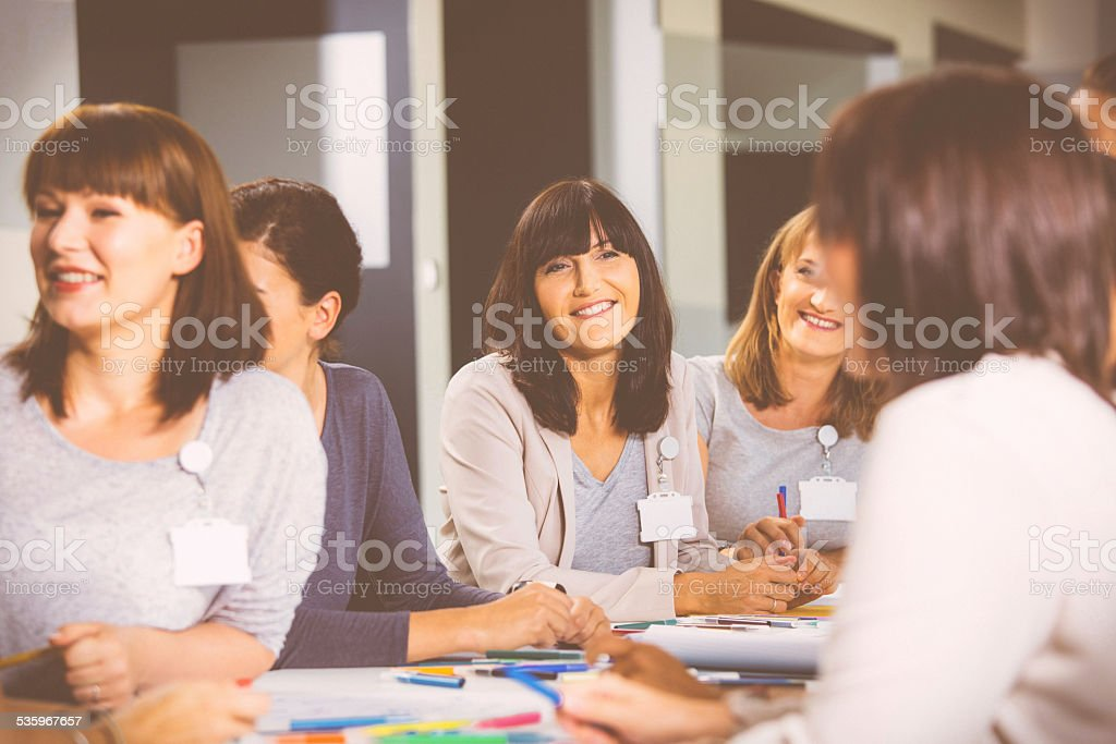 Group of women during seminar Group of women attending a training, working together and discussing. 2015 Stock Photo