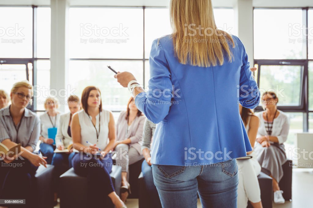 Group of women during seminar Group of women during seminar. Presenter standing in front of audience. Achievement Stock Photo