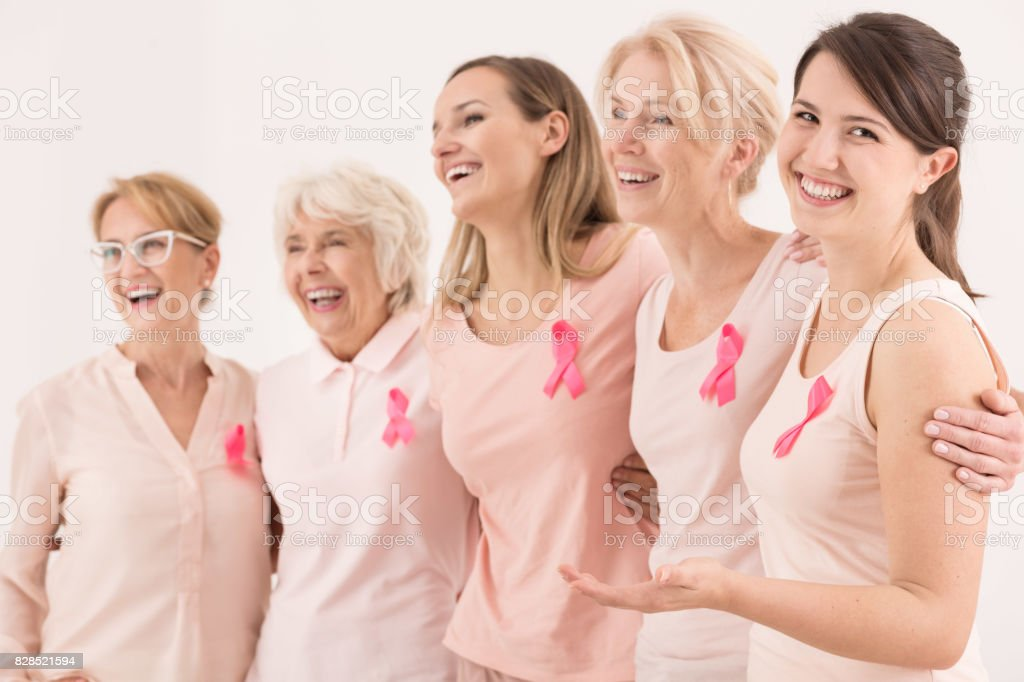 Group of women embracing stock photo