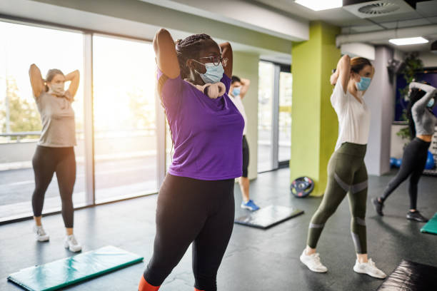 Group Of Women Exercising In The Gym - Reopening Business stock photo