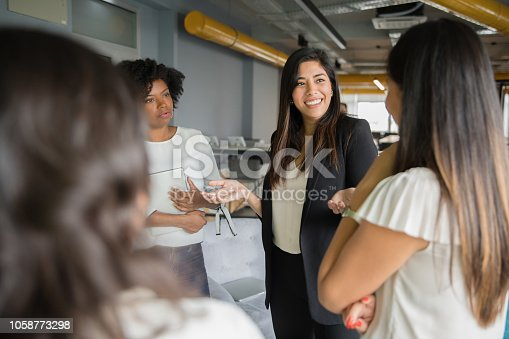 Businesswomen having informal conversation meeting in office