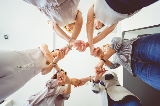 Group Of Women Holding Hands In Circle Stock Photo - Download Image Now