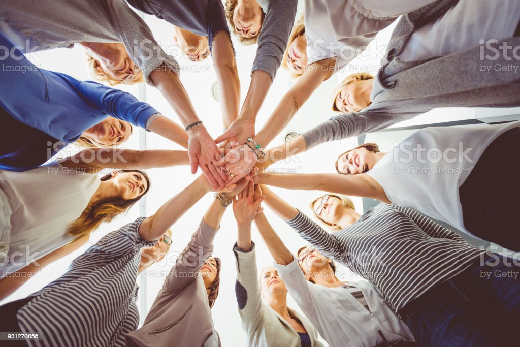 Group of women holding hands together Women's team. Group of woman at training, holding hands. Adult Stock Photo
