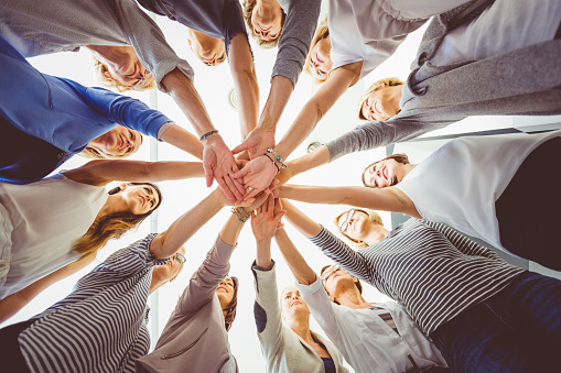 Group Of Women Holding Hands Together Stock Photo - Download Image Now