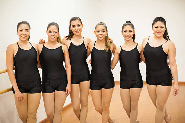 group of women in a dance studio - leotard stock photos and pictures