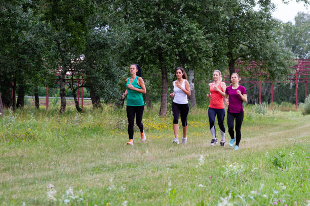 Group of women jogging together stock photo