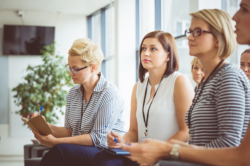 Group Of Women Listening To A Presentation Stock Photo - Download Image Now