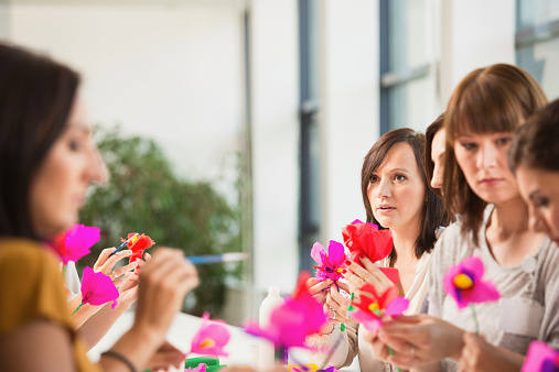 Group Of Women Making Paper Flowers Stock Photo - Download Image Now