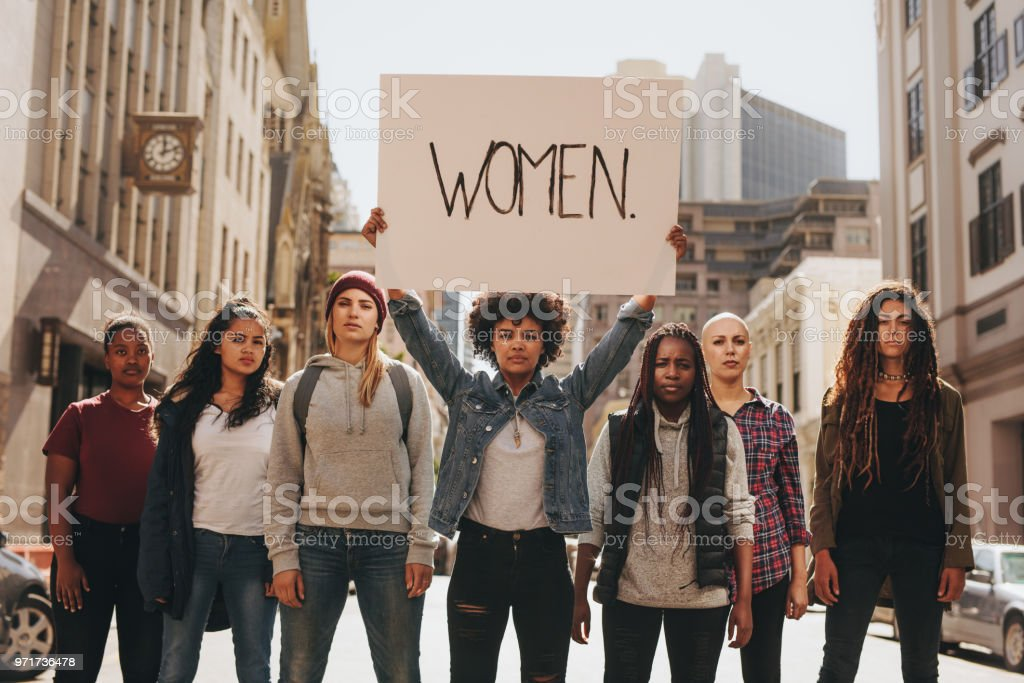 Group of women marching on the road in protest stock photo