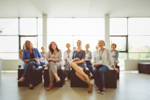 Group Of Women On Seminar Blured Image Stock Photo - Download Image Now