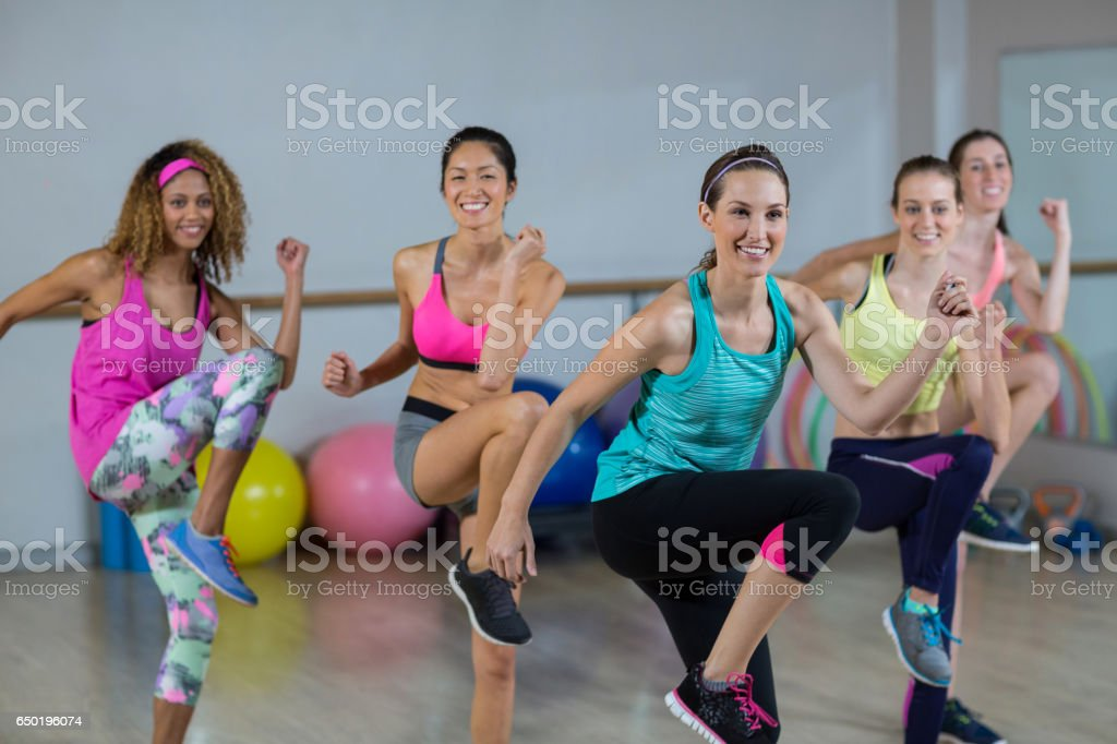 Group of women performing aerobics royalty-free stock photo