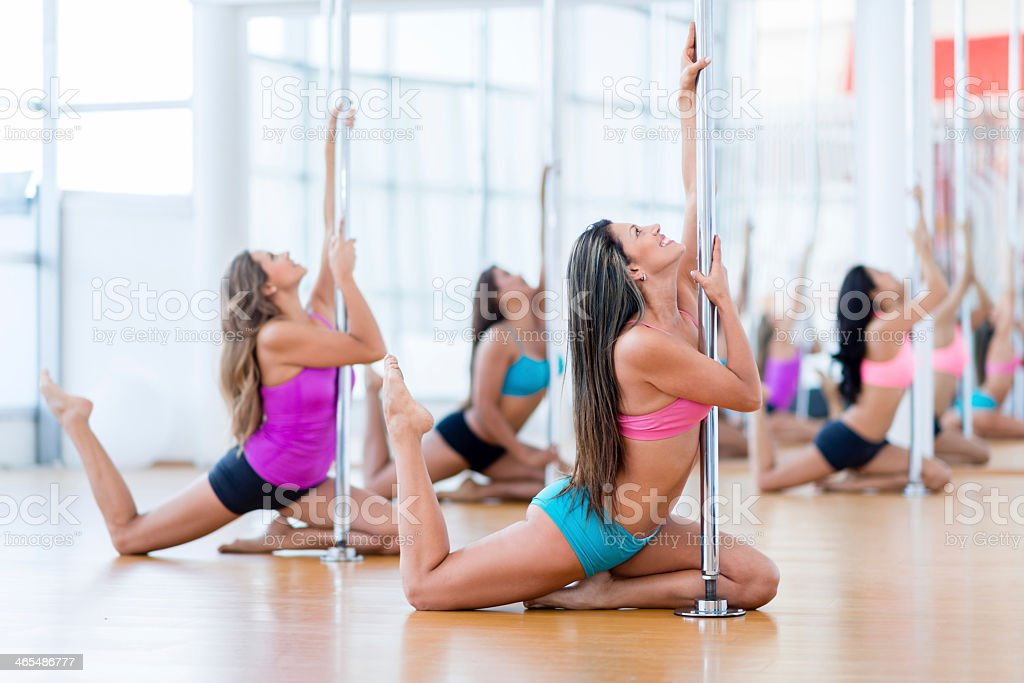 Group of women pole dancing stock photo