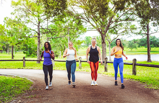 Group of athletic women walking outdoors