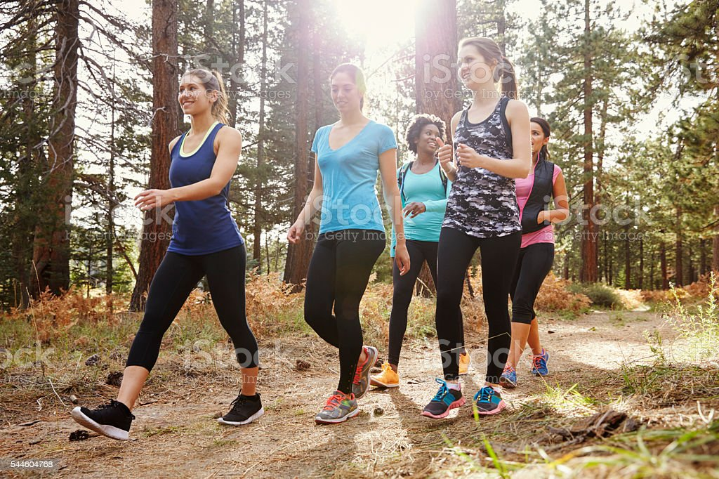 Group of women runners walking in a forest, close up royalty-free stock photo