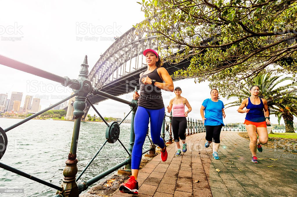 Group of Women Running by Sydney Harbour stock photo