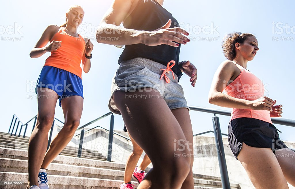 Group of Women Running Down the Staircase stock photo