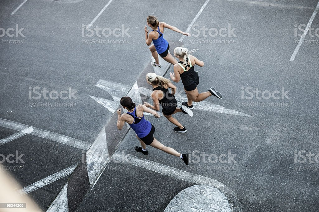 Group of women running in the city stock photo