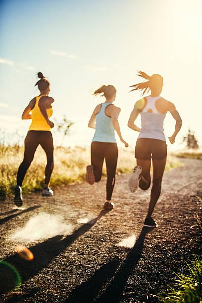 group of women running outdoors - jogging hill bildbanksfoton och bilder