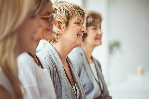 Group Of Women Sitting At A Seminar Stock Photo - Download Image Now
