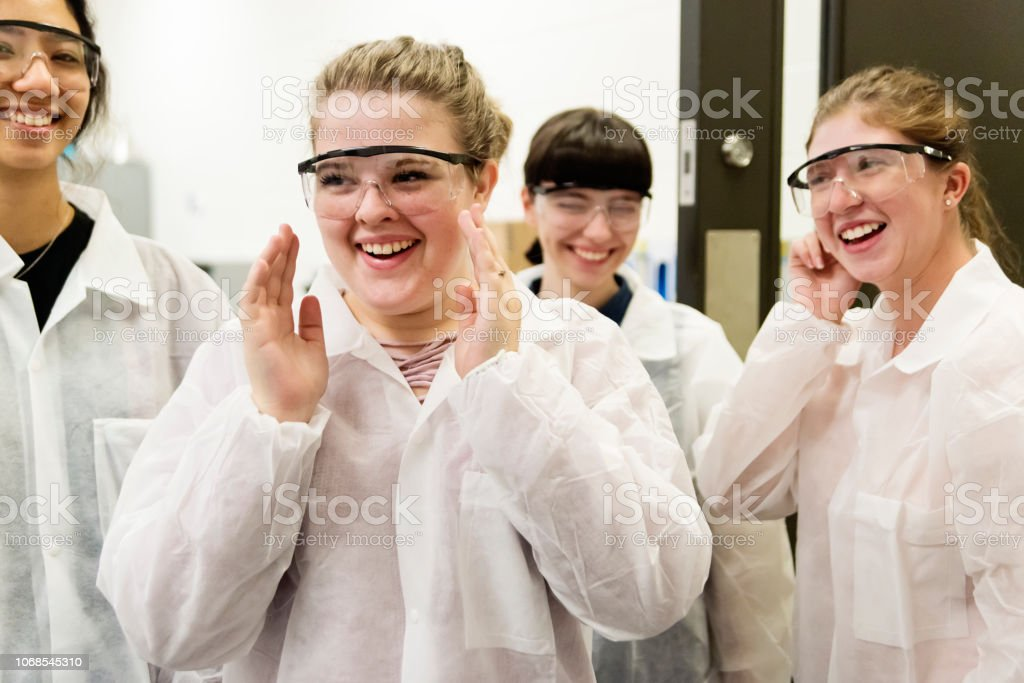 Group of women students in College pharmaceutical laboratory. stock photo